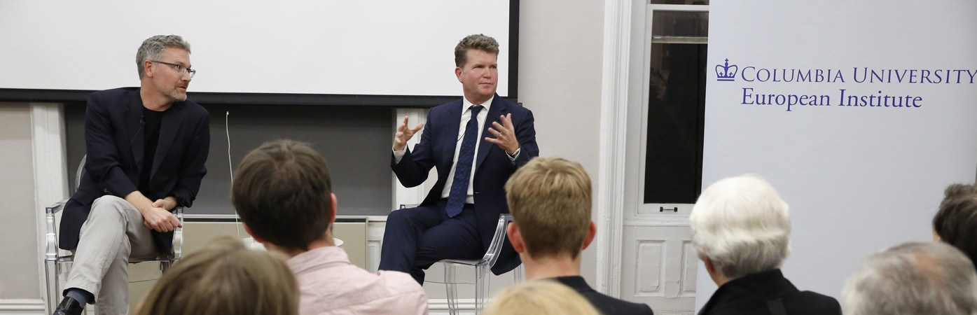 Professor Adam Tooze and Ambassador Matthew Barzun, seated next to the European Institute's banner, address a captivated room.