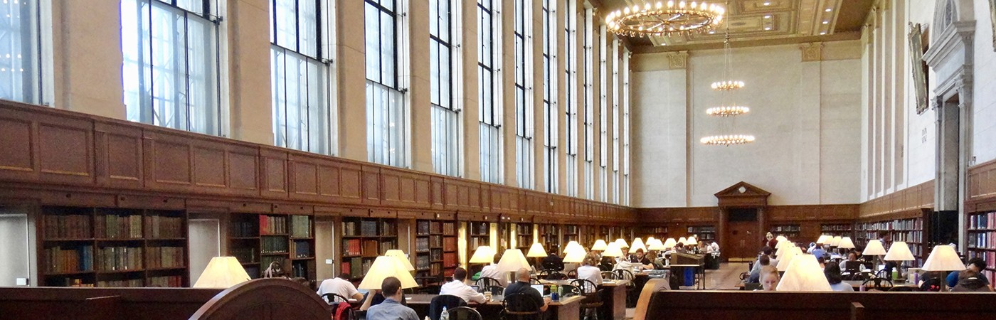 Students study and work at tables inside of Columbia University's Butler Library